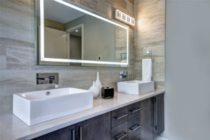 second surface mirror hanging in contemporary bathroom JNS Glass & Coatings Colorado